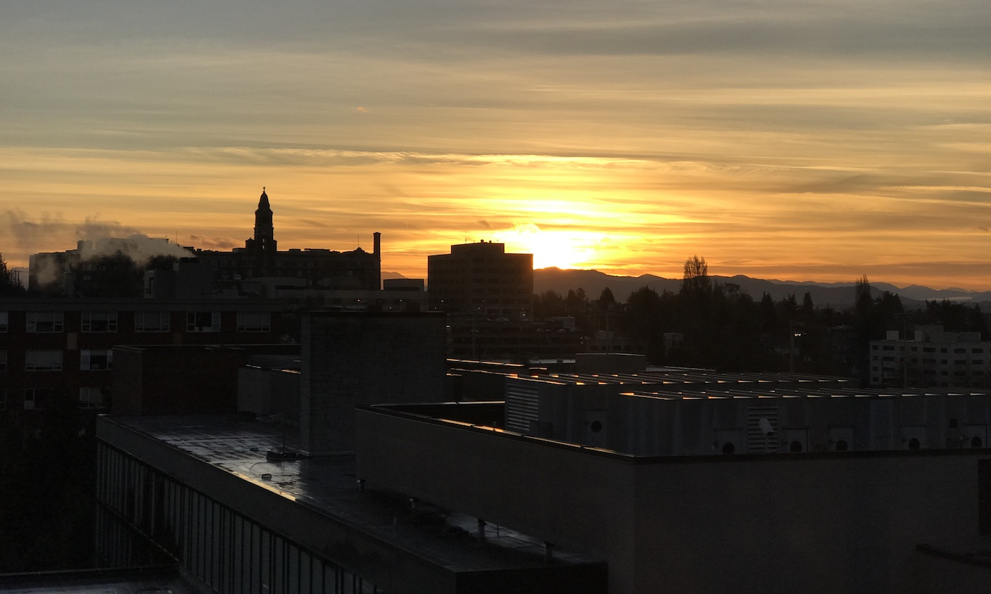 Seattle University sunrise over building tops